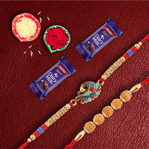 Pair Of Auspicious & Designer Rakhi With Dairymilk Chocolate